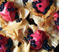 Phyllo Flowers With Sorbet and Blueberries: Recipes: Self.com : At under 330 calories per serving, this luscious, fruity dessert only tastes (and looks!) insanely indulgent. #SELFmagazine