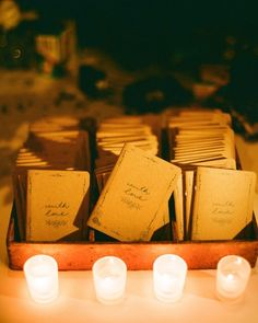 The design from the invite tag was stamped onto small notebooks from Scout Books, which were set out in a rustic box from The Upper Rust, a favorite antique store of the bride's in lower Manhattan.