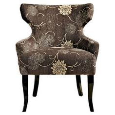 "T-backed accent chair with neutral floral upholstery and exposed wood legs.  Product: Accent chairConstruction Material: Fabric and woodColor: BrownFeatures:  Matching stained legsWide seat with soft cushions Dimensions: 34"" H x 29"" W x 26.5"" D"