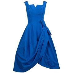 Pre-owned 1950s Blue Vintage Party Dress Dramatic Draping Side Bow 50s ($495) ❤ liked on Polyvore featuring dresses, evening dresses, draped dress, zipper dress, draped cocktail dress, metal dress and blue cocktail dress