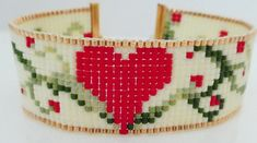 Excited to share the latest addition to my #etsy shop: Heart and Vines seed bead loom bracelet/cuff-gold, red, cream, and green miyuki delica seed beads with gold slide tube clasp #jewelry #bracelet #red #gold #seedbeadbracelet #victoriasdesignsus #miyuki #miyukidelica #heartbracelet #beadwork #loombracelet #beadedbracelet #valentinesday #handmade