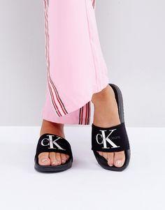 7756ae85fd6 Get this Calvin Klein s flat sandals now! Click for more details. Worldwide  shipping. Calvin Klein Jeans Chantal Black Slider Flat Sandals - Black   Sandals ...