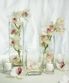 Google Image Result for http://www.elegantweddingcenterpieces.com/wp-content/uploads/2010/07/wedding-table-centerpieces-250x300.jpg