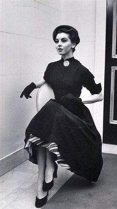 1951 Model is wearing dress with striped under-skirt from Ohrbach's department store, photo by Nina Leen