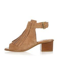 Beige suede fringed block heel sandals $76.00