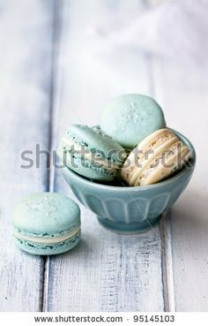 Pastel blue macaroons on wooden table by Ruth Black, via Shutterstock.