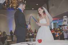 You'll be seeing more of Giovanna and Jonathan's Star Wars costume wedding (including Vader flower girl!) later this week, but I couldn't wait to tease their kick-ass candles-meet…