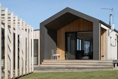 We love the combination of exterior finishes selected for the Kilcunda Project. The home features our Summit façade which creates a contemporary beach house vibe. The @colorbondsteel standing seam cladding is robust and architecturally modern. The locally sourced @radialtimber battens add natural warmth and contrast to the facade and blends with its environment. Photographer @coastalsnaps Contemporary Beach House, Build Your Dream Home, Prefab Homes, Outdoor Entertaining, Cladding, Facade, Floor Plans, Exterior, Contrast
