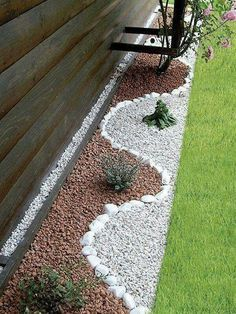 Rocks come in all shapes and sizes, and if you aren't keen on having too much weeding to do, a xeriscaped border area with minimal vegetation and artistically displayed rock is just what you need. You can easily customize your rock color and size to add depth and dimension to areas big and small.