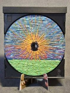 Crayon Painted CD - At Marlie's blog she explains how she melts crayons to create these unique painted CD's.