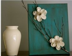 Paper flowers and twigs on canvas