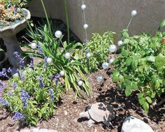 Next time you're at the Dollar Store, buy some ping pong balls and make this to make your garden extra gorgeous!