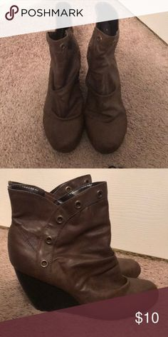Brown Wedge Booties Brown leather wedge booties. Brand is Decree. There are brass/copper colored circle accents that are around the front top and continue down both sides of the wedges - which is super unique and adds some flair! Made to have the slouchy look. The exterior of the wedges are in mint condition - as these are very gently used. Decree Shoes Ankle Boots & Booties