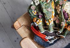Dekorativ taske ligg