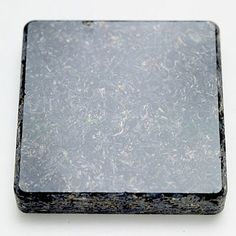 Countertop - A granite-like appearance for agriculture waste: Seeta by  TorZo, shown in Onyx (sunflower-seed hulls and acrylic polymer)