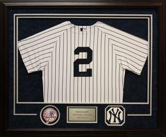 NY Yankees jersey framed in a custom shadow box