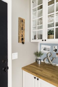 From old, cramped laundry closet to a functional entryway, work and storage space using DIY's on a budget! Check out all the after photos and links to sources...