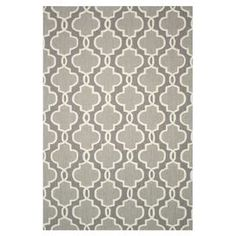 Hand-hooked rug with a quatrefoil motif in grey.     Product: RugConstruction Material: 100% PolyesterColor: GreyFeatures: HandmadeNote: Please be aware that actual colors may vary from those shown on your screen. Accent rugs may also not show the entire pattern that the corresponding area rugs have.Cleaning and Care: Clean spills immediately by blotting with a clean sponge or cloth. Vacuum carefully without beater bar.