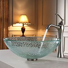 Add a touch of elegance to your bathroom with a Kraus clear glass vessel sink and faucet combination. Handcrafted from tempered glass, the modern bathroom sink coordinates with a variety of decor styl Bathroom Sink Bowls, Bathroom Sink Design, Modern Bathroom Sink, Ideal Bathrooms, Bathroom Faucets, Glass Bathroom, Bathroom Shelves, White Bathroom, Glass Shelves