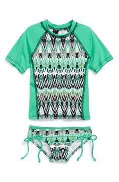 Free shipping and returns on Hurley 'Phoenix' Two-Piece Rashguard Swimsuit (Little Girls) at Nordstrom.com. A vibrant geometric print defines a raglan-sleeve rashguard that will keep her protected from the sun's harmful rays. Matching bottoms complete the water-ready look.