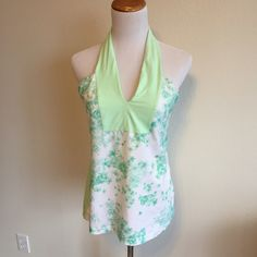 Lululemon stamped tank top Beautiful top used once , white and green flowers detail , size 10, it does have pockets for the inserts lululemon athletica Tops Tank Tops