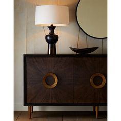 This credenza is built like your favorite antique. Crafted entirely of rift-cut oak, the best quality cut of wood, it is finished in a sable-toned veneer with bold, organic wood textures. Modern Baseboards, Table Easel, Mirrored Side Tables, Chair Rail Molding, Leather Counter Stools, Hand Sculpture, Silver Chandelier, Decorative Mouldings, Wood Texture