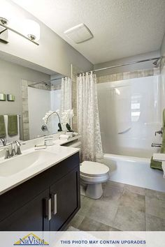 NuVista standard bathroom with upgraded floor tile Calgary, AB
