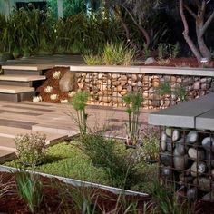 Gabion with  cconcrete cap.  Interesting idea for retaining wall http://www.gabion1.com.au