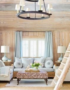 A country chic check pairs beautifully with a wood paneled wall. That fun punch of animal print provides the ideal juxtaposition.