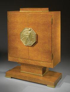 "Émile-Jacques Ruhlmann A FINE AND RARE ""MEUBLE Á FARDS"" CABINET, MODEL AR1524/NR2302 branded Ruhlmann and A plaque incised S. Foucault American burl walnut and gilt bronze 56 1/2 x 47 3/8 x 19 1/4 in. (143.5 x 120.3 x 48.9 cm) circa 1927 plaque cast from a model by Simon Foucault"