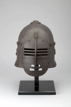 Namban kabuto. Japanese attempt at making an European helmet. Note the construction of the top section of the helmet  and the shape of the mouth.