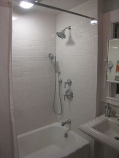 Clean Classic Bathroom with built-in storage, A 30 sqft bathroom remodeled with a pedestal sink 3x6 subway tile 1 inch hex tile and an incredible built-in custom medicine cabinet with full-length beveled mirror., , Bathrooms Design