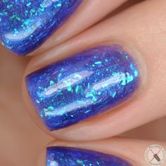 Colors by llarowe Holiday 2016 - Ho, Ho, Ho, It's Santa LaRowe - Purchase the full 8 set CbL Holiday 2016 Collection and receive this fabulous topper polish as a free bonus! This is a sheer bright blue multichrome flakie polish. Layer it over a complementary colour to embellish your manicure. Swatch courtesy of @polishedpatho.