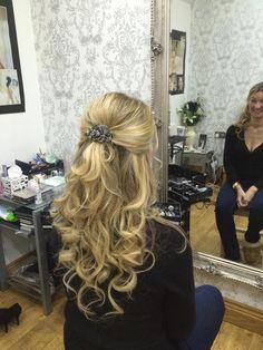 Half up half down wedding guest hairstyle