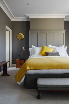 In the main bedroom of product designer Anthony Joseph - one half of kitchenware... In the main bedroom of product designer Anthony Joseph - one half of kitchenware company Joseph & Joseph - mustard textiles were chosen to complement the walls painted in Farrow & Ball's 'Mole's Breath'. http://tyoff.com/in-the-main-bedroom-of-product-designer-anthony-joseph-one-half-of-kitchenware/