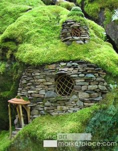 Emerald Mossy House by Sally J. Smith. An enchanted faerie house made of stones with willow twig windows and a moss roof.