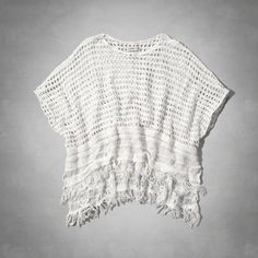 supersoft and drapey with an open stitch detailing and patterned knit, fringe detailing a hem, easy fit, imported<br><br>55% cotton / 33% acrylic / 12% polyester