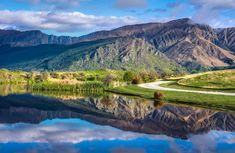 We headed out into the valley between the mountains of Arrowtown and Queenstown one morning. The air was crisp and clean. There was not even the slightest breeze to move the water around, so that made a countless array of perfect mirrors all over the estates. This was one of the final photos I got before a hasty exodus. - Queenstown, New Zealand - Photo from #treyratcliff Trey Ratcliff at http://www.StuckInCustoms.com