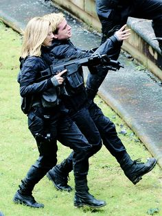 Josh Hutcherson and Natalie Dormer mid-action scene on the set of Mockingjay on May 13th, 2014