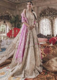 Pakistani Bridal Gold Tissue Lehnga for Wedding in classy look emblazoned with pretty work. Buy Latest Pakistani Bridal Gold Tissue Lehnga Online in USA.