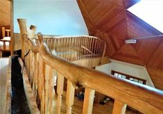 Upper level geodesic dome house,  natural wood rails,  room, rastick log bed, oak floor, wood wall,  wall light fixture, home for sale, 9121 CR 23 Brainerd MN 56401 Geodesic Dome Homes, Log Bed, Wall Light Fixtures, Dome House, Small Ponds, Safe Haven, Wind Power, Water Conservation, Ceiling Height