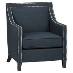 Showcasing eye-catching nailhead trim and a welted cushion, this elegant arm chair brings stylish appeal to your living room or home library.