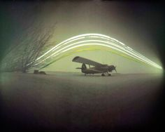 Explanation: From January 11 to February 25 2013, a pinhole camera sat in a field near Budapest, Hungary, planet Earth to create this intriguing solargraph. And for 45 days, an old Antonov An-2 biplane stood still while the Sun rose and set. The camera's continuous exposure began about 20 days after the northern hemispere's winter solstice, so each day the Sun's trail arcs steadily higher through the sky. These days in the Sun were recorded on a piece of black and white photosensitive paper tucked in to the simple plastic film container. The long exposure produced a visible color image on the paper that was then digitally scanned. Of course, cloudy days left gaps in the solargraph's Sun trails. http://apod.nasa.gov/apod/ap150221.html