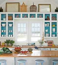 Breathe life into your kitchen by revamping your cabinets. Paint the back of doorless or glass-front cabinetry a favorite coastal shade. When paired with white dishes and wicker or wood baskets, it brings a shabby chic vibe to a casual beach home.