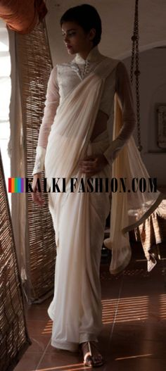 Buy Online from the link below. We ship worldwide (Free Shipping over US$100) http://www.kalkifashion.com/a-gaurav-gupta-cream-pre-draped-saree.html A Gaurav Gupta cream pre draped saree