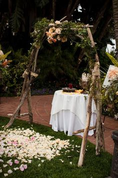 simple wedding wedding altar with flowers and greenery
