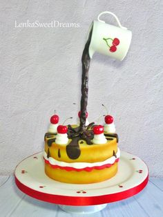 Anti-gravity cake with chocolate and cherries.