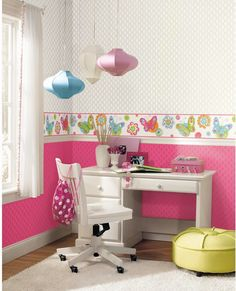 Any young girl would love the bright pink lattice wallpaper with a glitter outline with the brightly colored butterfly border. Cool Kids by York Wallcoverings.