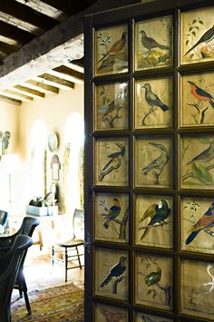 Bird art in panels of old door. Cathy Kincaid Interiors
