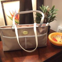 """Franco Sarto Tan Handbag w/White Trim In the 4th pic you can see 2 small marks on the white trim..  Also has 4 studs on the bottom of the bag.  13"""" Length-8"""" High, 21/2"""" Wide Franco Sarto Bags"""